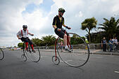 Eastbourne, East Sussex, UK. 14th June 2015. Competitors take part in the Penny Farthing Championship bike race during the Eastbourne Cycling Festival. © Scott Ramsey/Alamy Live News - Stock Image - ETJMTX
