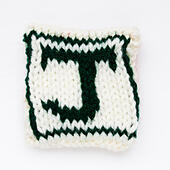 letter J Knitted woollen lettering. - Stock Image - ED87CH