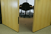 Doors are open to empty highrise building conference room - Stock Image - AY8E53