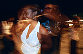 CUBA HAVANA Young Cuban couple dancing outdoors at the Malecon seafront at night - Stock Image - A0XTH5