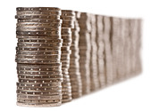 Close-up stacks of 2 Euros Coins in front of white background - Stock Image - CB7EW1