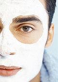 Man wearing facial mask, close-up, partial view, portrait. - Stock Image - AWRNC1
