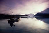 Canoeist on Trail Lake Sunrise Kenai Peninsula AK Kenai Mtns Summer Fog - Stock Image - A0YE65