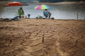 Sao Paulo, Brazil. 17th Oct, 2014. Men fish in the Atibainha dam, that forms part of the Cantareira System, responsible for providing water to metro Sao Paulo, in Nazare Paulista, Sao Paulo state, Brazil, on Oct. 17, 2014. The level of the Cantareira System, that provides water for around 6.5 million people, is beneath 4 percent of its total capacity, due to the worst drought that Sao Paulo has suffered in decades, according to local press. © Rahel Patrasso/Xinhua/Alamy Live News - Stock Image - E93533
