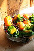 Close-up of bell peppers and gourd in bowl - Stock Image - A7T7BW