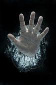 Open hand beneath water - Stock Image - DADT55