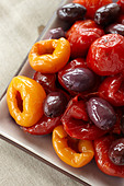 Olives and peppers, close up - Stock Image - CN32F1