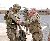 U.S. Army Command Sgt. Maj. Russel Reimers, right, the senior enlisted advisor to the commander of the 1st Stryker Brigade Comb - Stock Image - E1J1P3