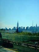 Artistic View of the Manhattan Skyline as Viewed from the Highway in Queens New York City USA Copy Space - Stock Image - AT66XY