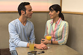 young couple having a conversation in restaurant - Stock Image - A3KWRA