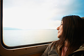 Woman looking out train window - Stock Image - CRC657