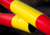 Closeup of red and yellow striped metal boom - Stock Image - C786FG