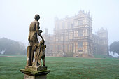 "Nottingham, UK. 4th November, 2014. Misty start to the day at Wollaton Hall and Park, Nottingham. 4 November 2014  The sun starts to burn of autumnal early morning fog over the Elizabethan country house, Wollaton Hall, was used as Wayne Manor in the Batman film, ""The Dark Night Rises"" © Martin P Wilson/Alamy Live News - Stock Image - E9XXX9"