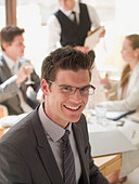 Business people having working lunch - Stock Image - BCA1JA