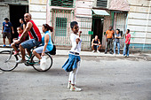 A girl dances in the streets of Havana Cuba - Stock Image - BNGH09