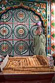 Boy sells biscuits outside mosque, Hassan Abdal market, Pakistan - Stock Image - A6C8XB