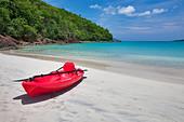 Red canoe at Megan's Bay. St. Thomas. US Virgin Islands. - Stock Image - BREY8B
