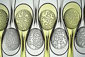 Carbonated liquids in plastic spoons - Stock Image - BJHH69
