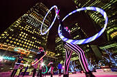 London, UK. 6th Nov, 2014.  Canary Wharf Ice Rink launches with 'Human Fire Torch' spectacle © Guy Corbishley/Alamy Live News - Stock Image - EA4PEE