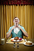 Caucasian man preparing to eat dinner - Stock Image - CC7FAW