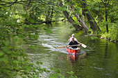 Two men canoeing on Wuerm River in southern Bavaria, Upper Bavaria, Germany - Stock Image - BY6Y0E