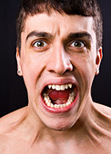 Scream of shocked and scared young man - Stock Image - B8KMGM