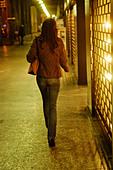 Italy, Milan, Lady walking down the street - Stock Image - AKJD10