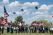 Tucson, Arizona, USA. 24th May, 2014. Apache helicopters fly over the interrment ceremony for Command Sgt. Maj. MARTIN BARRERAS in Tucson, Ariz. Barreras was wounded earlier in May after his unit came under fire in Herat Province, Afghanistan and died May 13, 2014 in Texas. Barreras is the most recent U.S. serviceman killed as a result of enemy action in Afghanistan. © Will Seberger/ZUMAPRESS.com/Alamy Live News - Stock Image - E16PX9