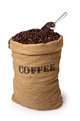 Burlap sack of coffee beans with scoop - Stock Image - ABRFYB