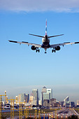 British Airways airliner landing at London City Airport, England, UK - Stock Image - CYHJ4Y