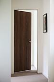 Open door leading off hallway - Stock Image - D0XRH2