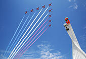 Goodwood, West Sussex, UK. 26th June, 2015. The Red Arrows, pictured flying over the 2015 Goodwood Fesival of Speed sculpture. This sculpture includes Mazda's rotary-engined 787B Le Mans racer and its LM55 Vision Gran Turismo concept car. The Goodwood Festival of Speed is an annual hill climb featuring historic motor racing vehicles held in the grounds of Goodwood House, West Sussex. © Oliver Dixon/Alamy Live News - Stock Image - EWJ9F5