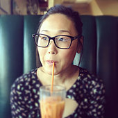 Korean woman drinking iced tea in cafe - Stock Image - D6YJM1