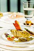 Red snapper with aioli, olive gnocchi and green asparagus - Stock Image - BJKPM4