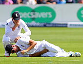 Cardiff, Wales. 09th July, 2015. Joe Root laughs as captain Alastair Cook of England lays on the floor after being hit in the midriff during day two of the 1st Investec Ashes Test match between England and Australia at SWALEC Stadium on July 9, 2015 in Cardiff, United Kingdom. © Mitchell Gunn/ESPA/Alamy Live News - Stock Image - EX8YYH