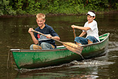 two young boys in a canoe - Stock Image - A03NCM