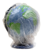Globe wrapped in bubble wrap - Stock Image - B3X1BH