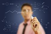 Asian teacher writing scientific formula on the whiteboard. - Stock Image - C7WPM3