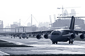 Commercial airplanes in queue at airport - Stock Image - ATMRM2