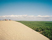 Sand dune and people - Stock Image - AWDX9W
