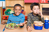 Two boys having their lunch - Stock Image - BJRDW1