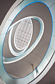 low angle view into staircase of office building - Stock Image - C12YCF