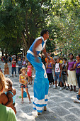 Long Leg Street Performer man dancing at street to entertain children. Havana (Habana), Cuba - Stock Image - C3EB42