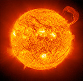 photograph of the sun taken with a huge telescope show flames erupting from the surface - Stock Image - A6WGKH
