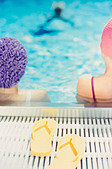 Rear view of two people in swimming pool - Stock Image - A7T5YM