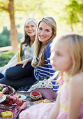 Three generations of women picnicking - Stock Image - CNMG2M