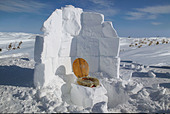 Open air toilet built from blocks of snow and with fur lined seat - Stock Image - A97F6F