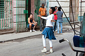 A girl dances in the streets of Havana Cuba - Stock Image - BNGGXD