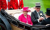 epa04802785 Britain's Queen Elizabeth II (L) and Prince Philip, Duke of Edinburgh (R) arrive in a horse-drawn carriage on the opening day of Royal Ascot near London, Britain, 16 June 2015. Royal Ascot runs through 20 June.  EPA/WILL OLIVER - Stock Image - EW7X1D