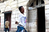 A girl dances in the streets of Havana Cuba - Stock Image - BNGH10